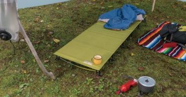 A backpacking cot with other camping implements